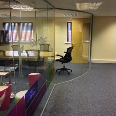 Curved frameless glass offices