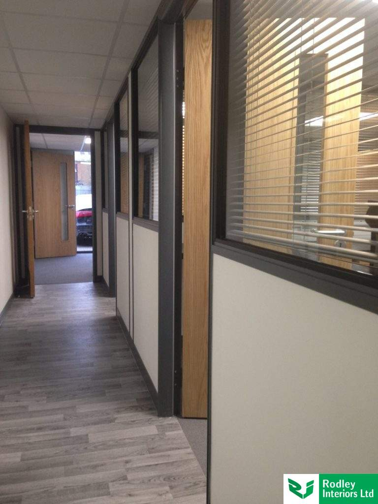 Walkway vinyl leading to carpet tiles in the office areas.