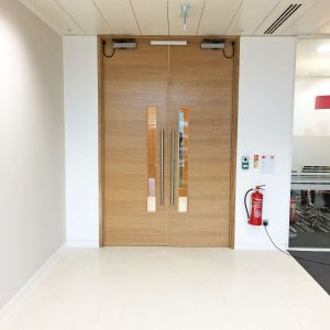 Self closing office entrance doors