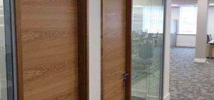 Double glazed frameless glass partitioning