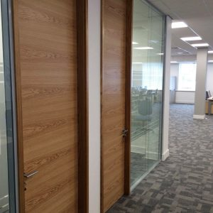 Double glazed frameless glass partitioning