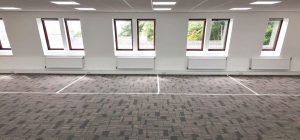 Single glazed partitioning works begin for Leeds security systems firm