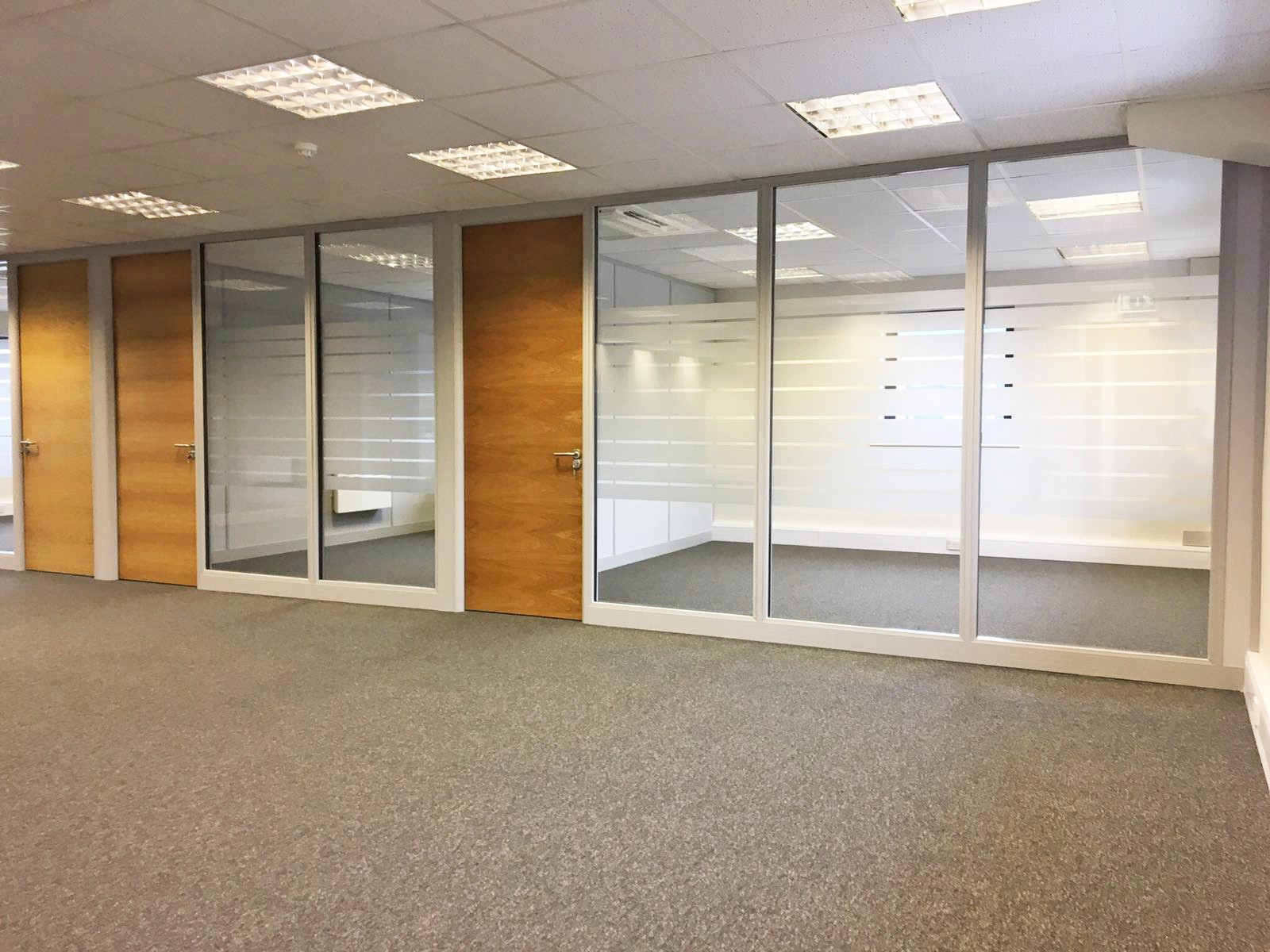 Case study internal glass office partitioning for Office design west yorkshire