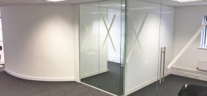 Frameless glass partitioning install continues in Leeds