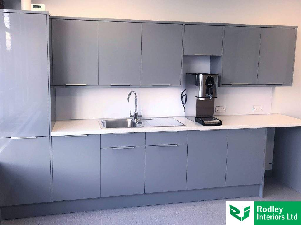 grey kitchen units with instant water boiler