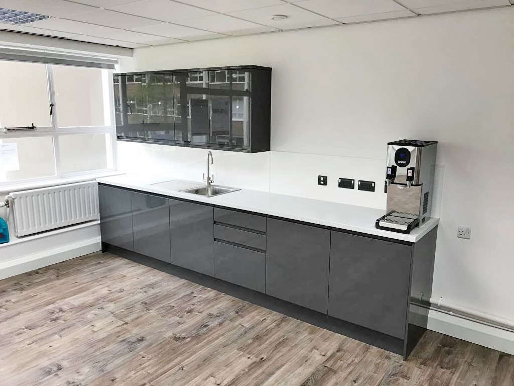 workplace kitchen with wood effect flooring