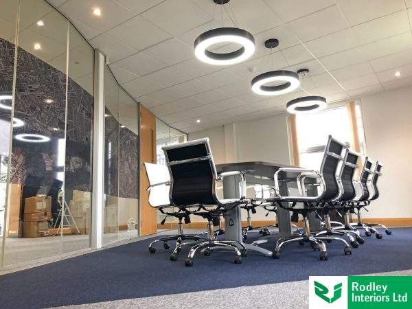 circular pendant lights fitted in new boardroom