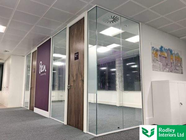Meeting rooms formed from full height glass partitions