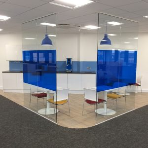 breakout kitchen area defined by glass partitioning panels