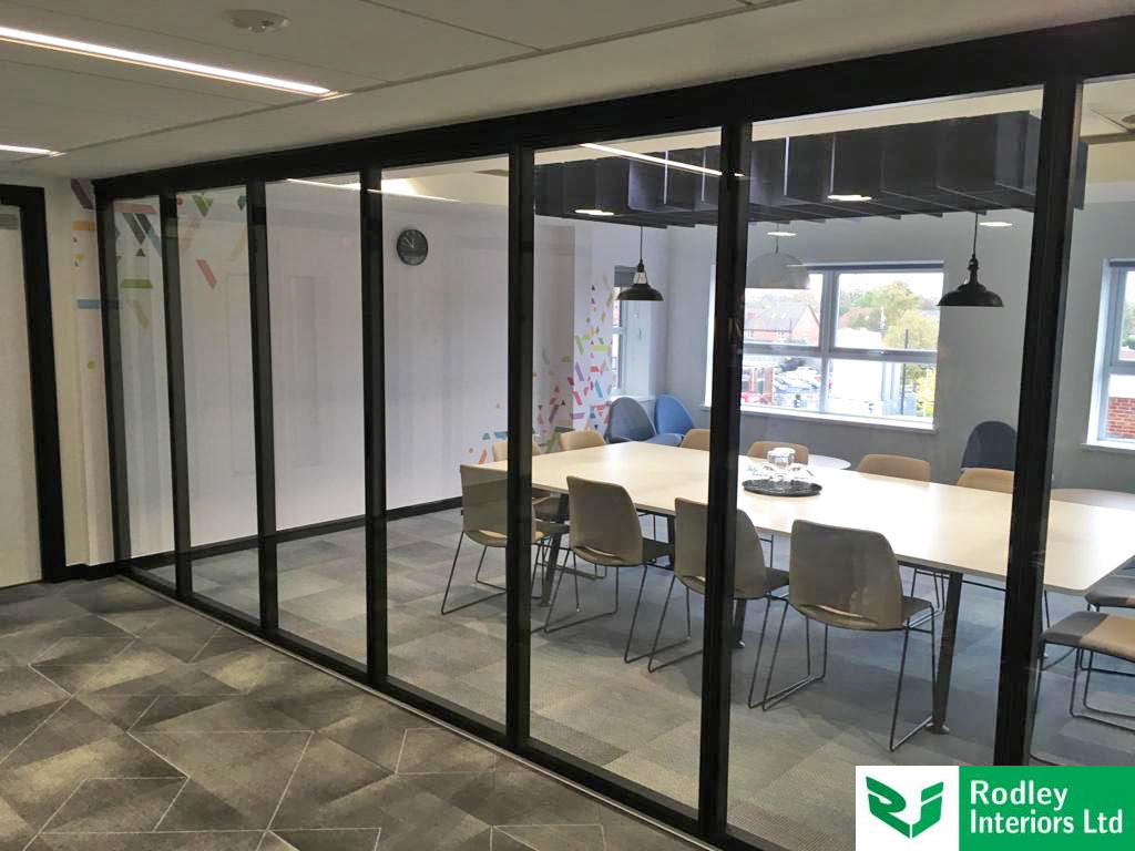 Versatile glass room dividers with black framework detail