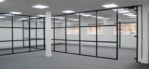 Glazed office partitions with black banded framework